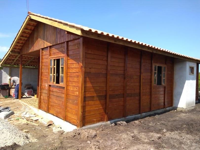 Casas de madeira no sistema economico